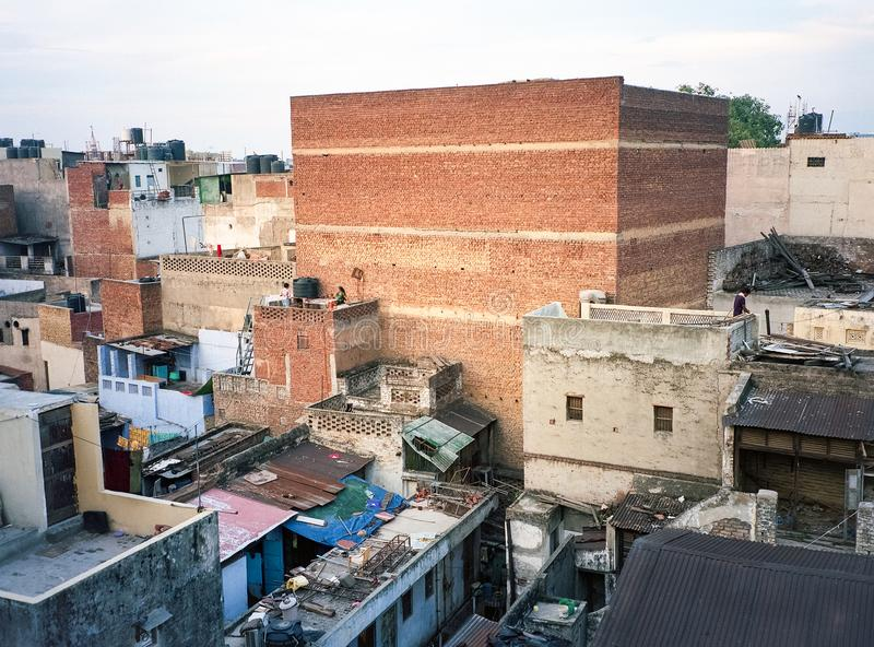 New Delhi India rooftops of Paharganj quarter area poor neighborhood on clear summer day. Drying laundry royalty free stock photo