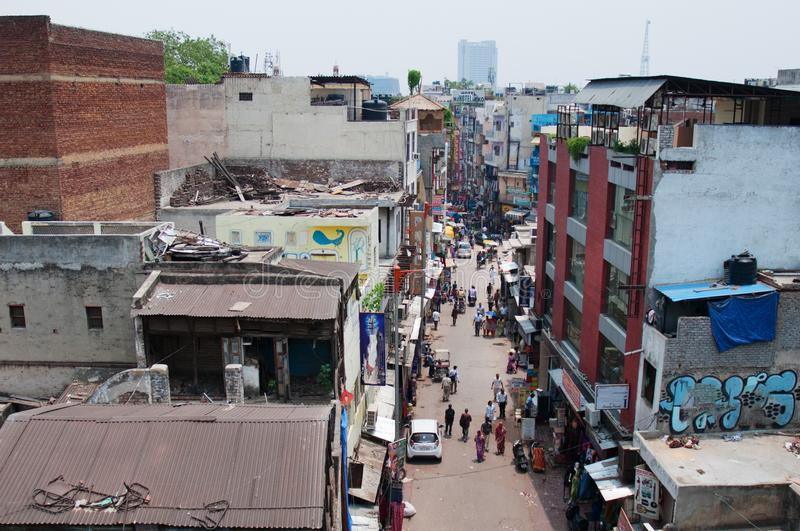 New Delhi India rooftops of Paharganj quarter area poor neighborhood on clear summer day. Drying laundry stock photography