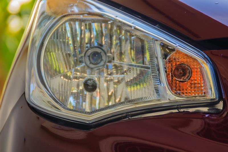 New design rear light of red saloon car. Closeup of Car rear light, Detail of modern car rear lamp red color. stock photography