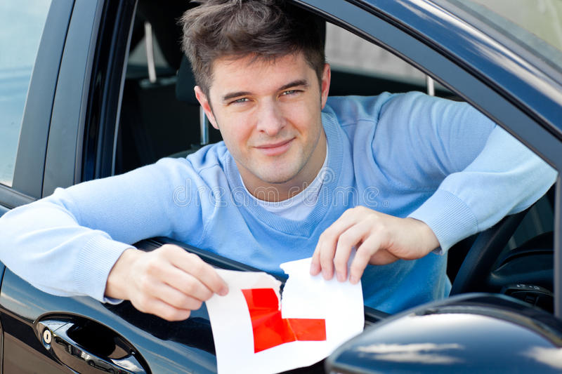 New Driver Tearing Up His L Sign Royalty Free Stock Image