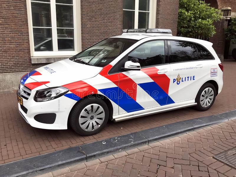 New Dutch national police car. Amsterdam, the Netherlands - July 15, 2019:  Dutch national police car parked by the side of the road. Nobody in the vehicle stock images