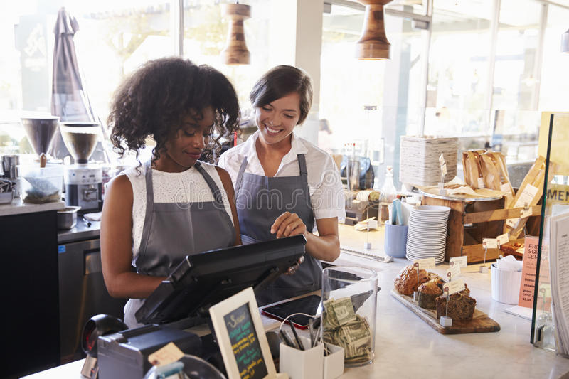 New Employee Receives Training At Delicatessen Checkout stock photography