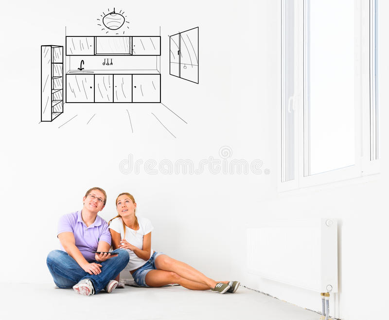 New empty apartment. Couple at their new empty apartment stock images