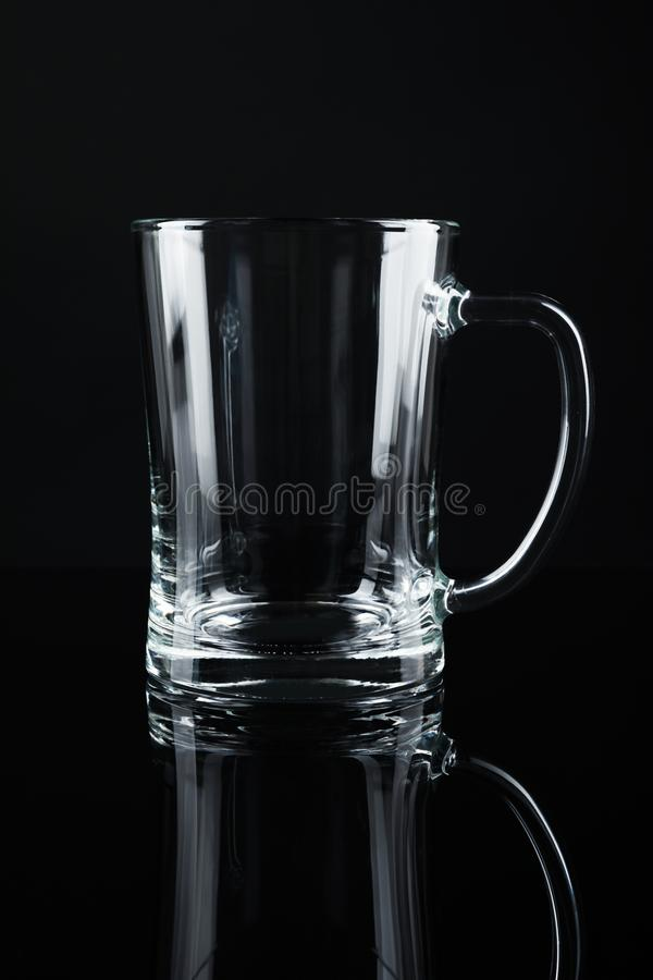New empty beer glass. On black background royalty free stock photo