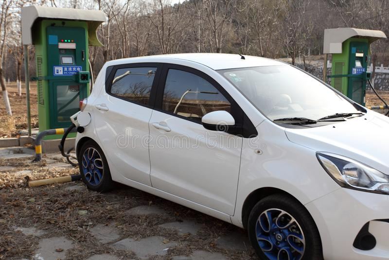 New energy vehicle is charging. stock photo