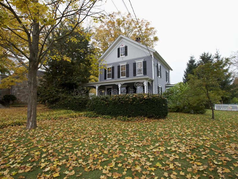 New England American home in Fall. New England wooden house in Fall, Connecticut, USA royalty free stock image
