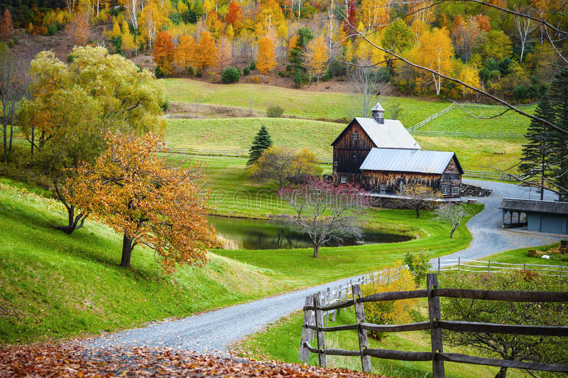 New England countryside, farm in autumn landscape. Fall foliage, New England countryside at Woodstock, Vermont, farm in autumn landscape. Old wooden barn royalty free stock image