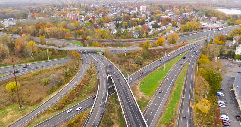 New England Highways East Hartford Connecticut Aerial. Fall color fills the tress around the urban landscape of East Hartford Connecticut in New England stock photo