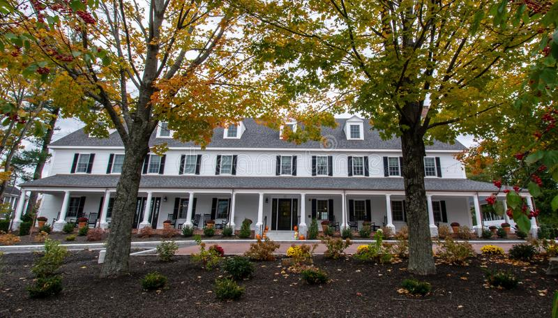 A new New England Inn modeled after an old Inn on an overcast late fall day royalty free stock images