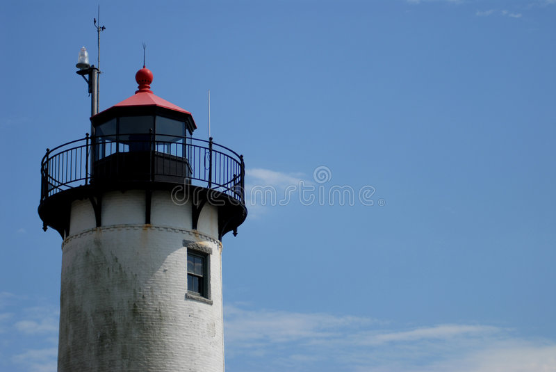 New England Lighthouse 1. New England lighthouse with blue sky and room for copy stock photo
