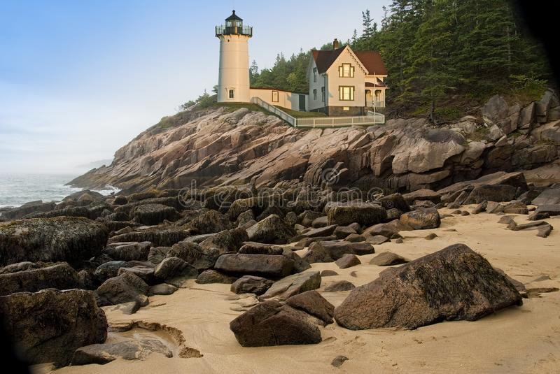 New England lighthouse. On a cliff in Maine, overlooking the Atlantic ocean stock photography