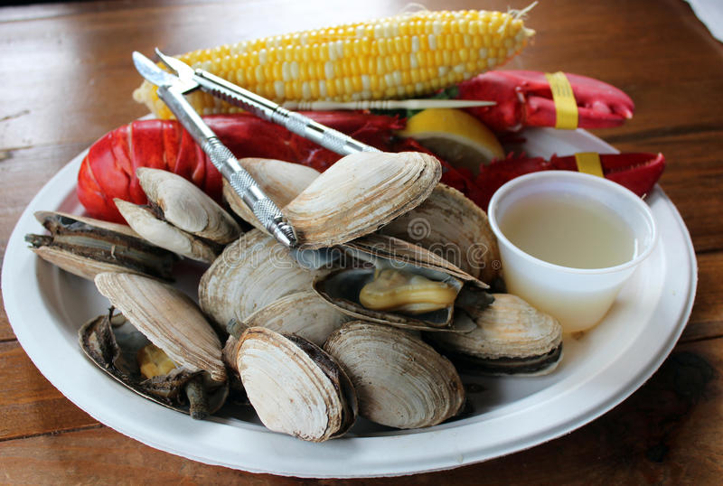 New England Lobster Bake. A traditional New England lobster bake, which includes clams, corn on the cob and lobster royalty free stock image