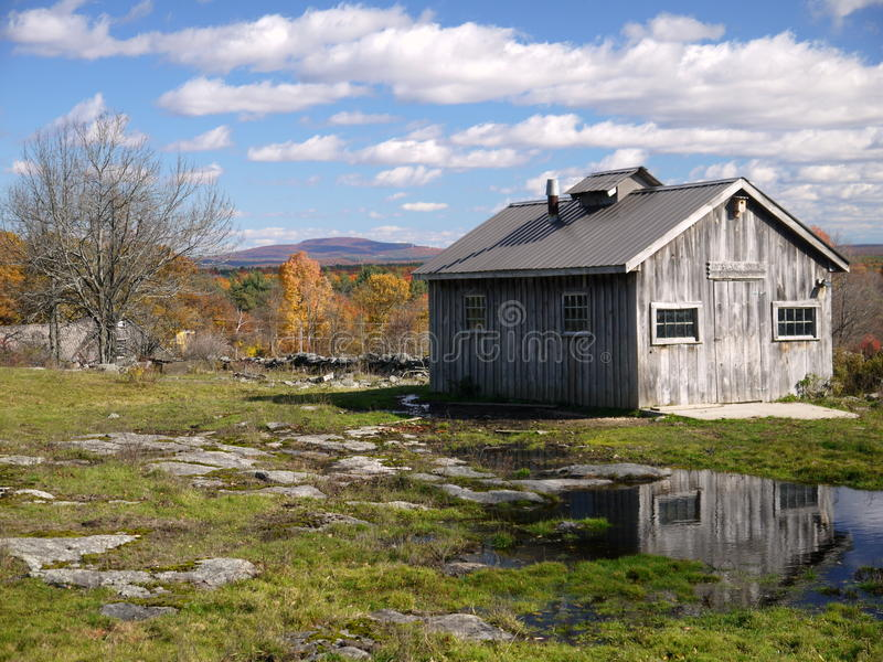 New England: maple sugar shack in autumn fall. New England maple sugar shack in autumn fall with Mount Wachusett beyond royalty free stock images