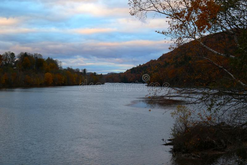 New England River in Fall. A river in New England at the end of fall and right before sunset stock photography