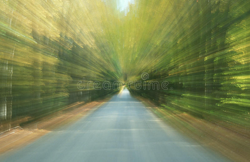 New England Road blurred. A New England road 'in motion' in autumn royalty free stock image