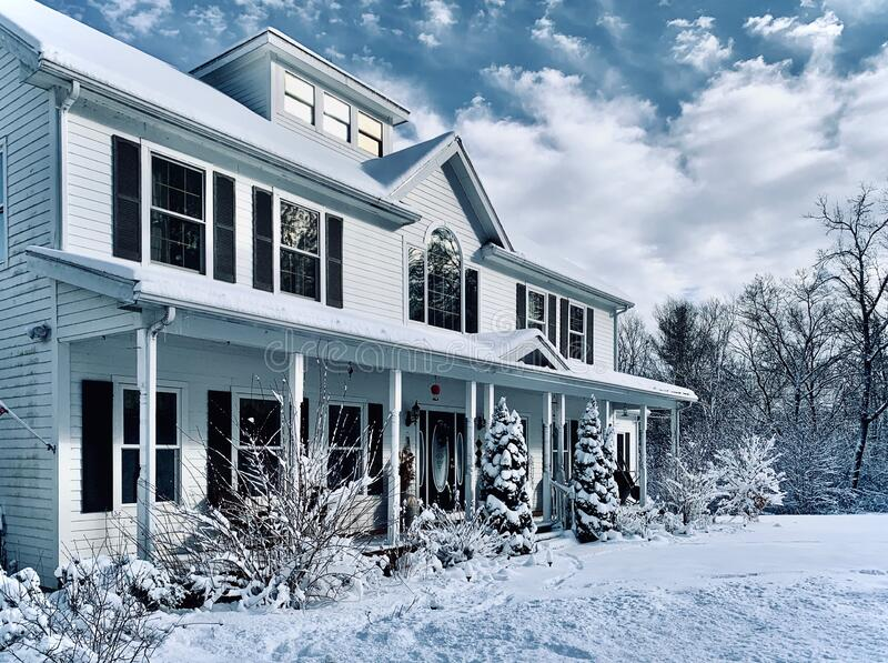 A New England White Colonial in Winter royalty free stock photo