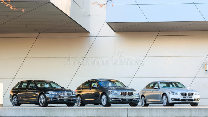 New entire model line of powerful BMW 535 family and business cl. MUNICH, GERMANY - DECEMBER 27, 2013: New entire model line of powerful BMW 535 family and stock photos