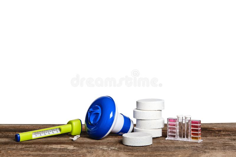 Equipment with chemical cleaning products and tools for the maintenance of the swimming pool on a wooden surface against. New equipment, chemical cleaning royalty free stock photography