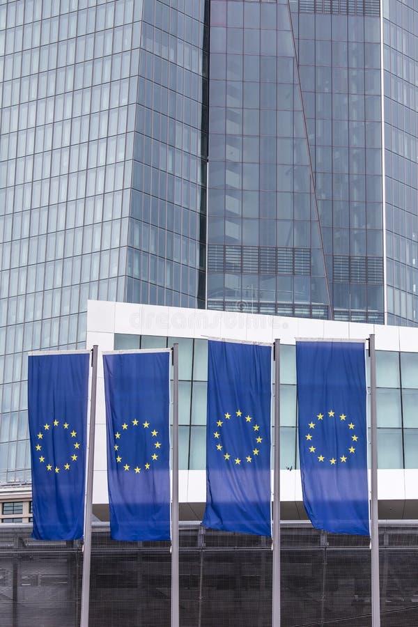 New european central bank in frankfurt germany with europe flags. The new european central bank in frankfurt germany with europe flags royalty free stock photo