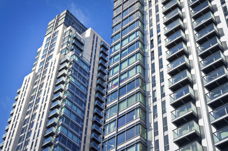 New executive apartment buildings. Modern, new executive apartments and with deep blue summer sky royalty free stock photo