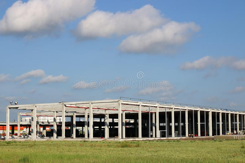 New factory construction site with workers. Industry royalty free stock photos