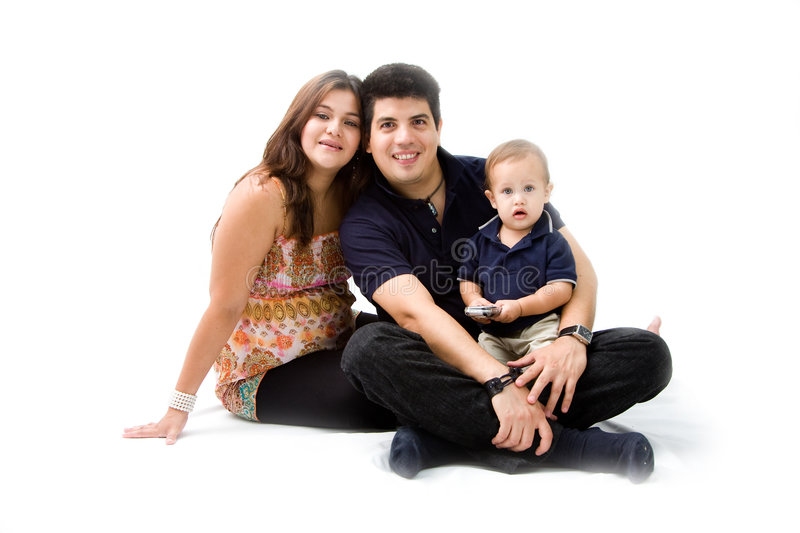 New family. Mother, father and son as a young new family sitting together, isolated