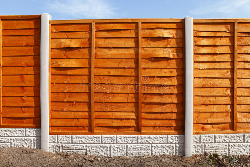 New fence panels. New fitted 6 foot wooden treated fence panels with concrete posts and gravel boards stock photos