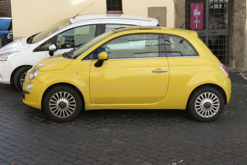 New Fiat 500. ROME, ITALY - CIRCA OCTOBER 2015: Yellow Fiat 500 car (new version) parked in a street of the city center royalty free stock photo