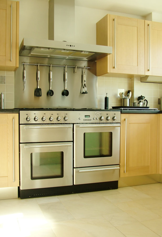 New fitted kitchen. A Sliver double cooker in natural light royalty free stock image