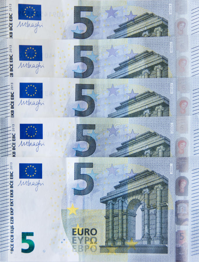 New five euro banknote money bank. New five euro banknote currency royalty free stock images
