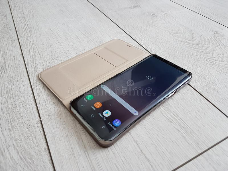 New flagship edition - curved screen phone with open active book cover stock image