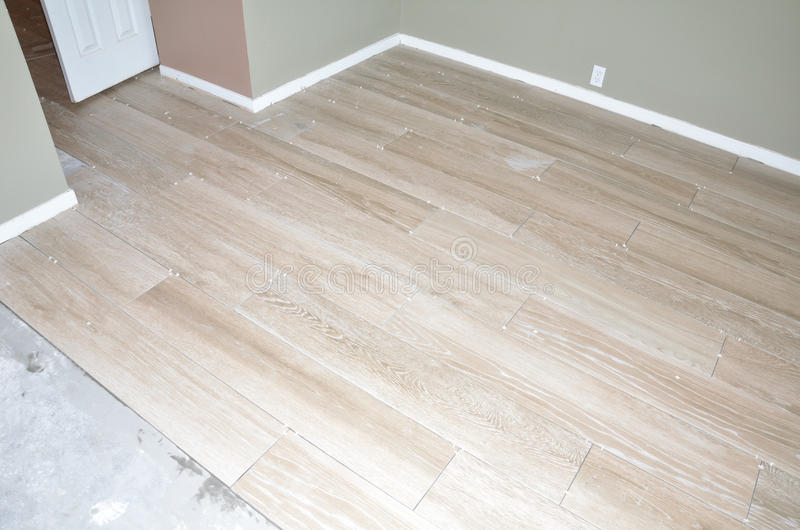 New Flooring Tile. New porcelain tiles during installation of home remodel royalty free stock images