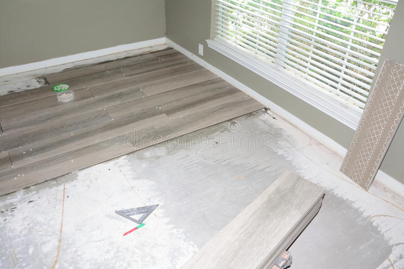 New Flooring Tile. New porcelain tiles during installation of home remodel stock photos