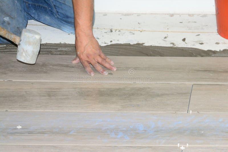 New Flooring Tile. New porcelain tiles during installation of home remodel stock photo