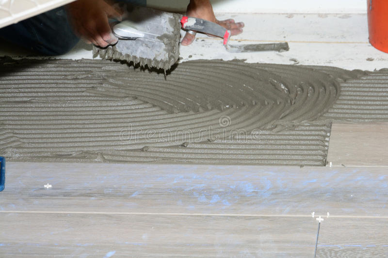 New Flooring Tile. New porcelain tiles during installation of home remodel royalty free stock photos
