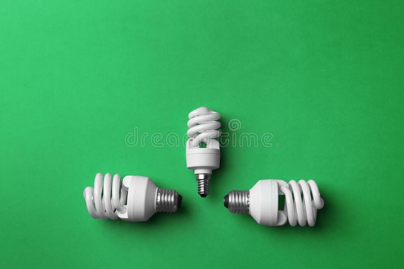 New fluorescent lamp bulbs on green background stock photo