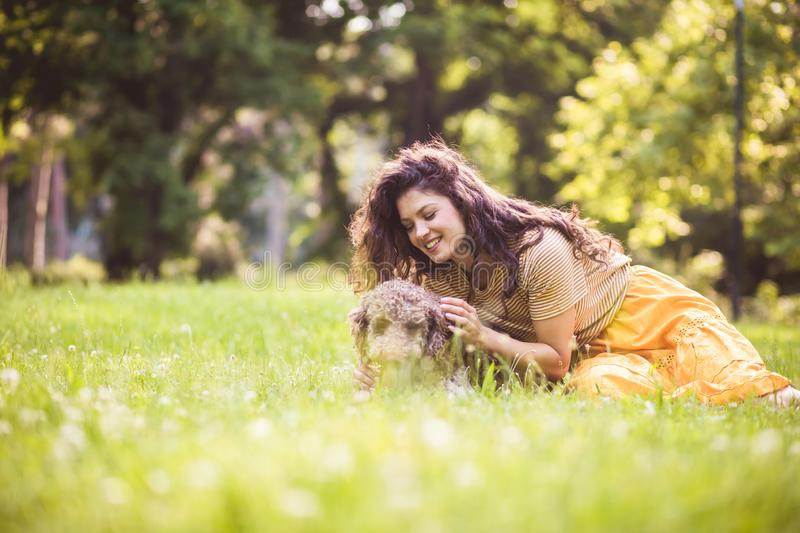 New friend. Woman in nature with dog royalty free stock photography