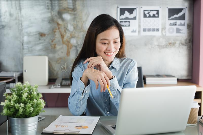 New generation asian business woman using laptop at office, Asian women sitting smiling while working on mobile office concept. New generation asian business stock images