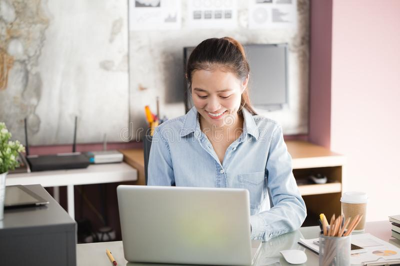 New generation asian business woman using laptop at office, Asian women sitting smiling while working on mobile office concept. New generation asian business royalty free stock photo