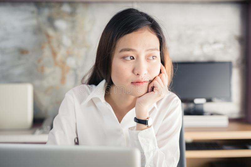 New generation asians business woman using laptop at office. New generation asian business woman using laptop at office,Women are sitting using the idea royalty free stock image