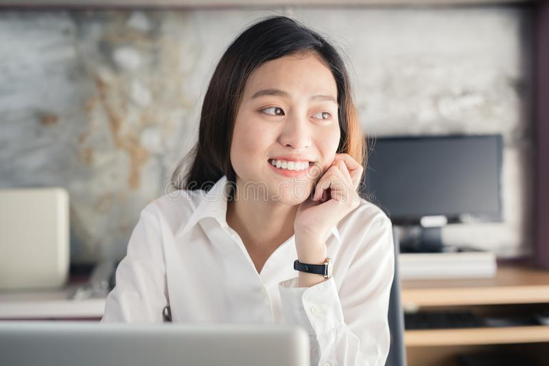 New generation asians business woman using laptop at office,Asian women sitting smiling while working on mobile office concept. New generation asians business royalty free stock photo
