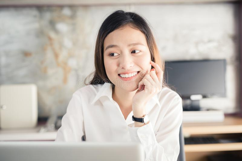 New generation asians business woman using laptop at office,Asian women sitting smiling while working on mobile office concept. New generation asians business stock photos