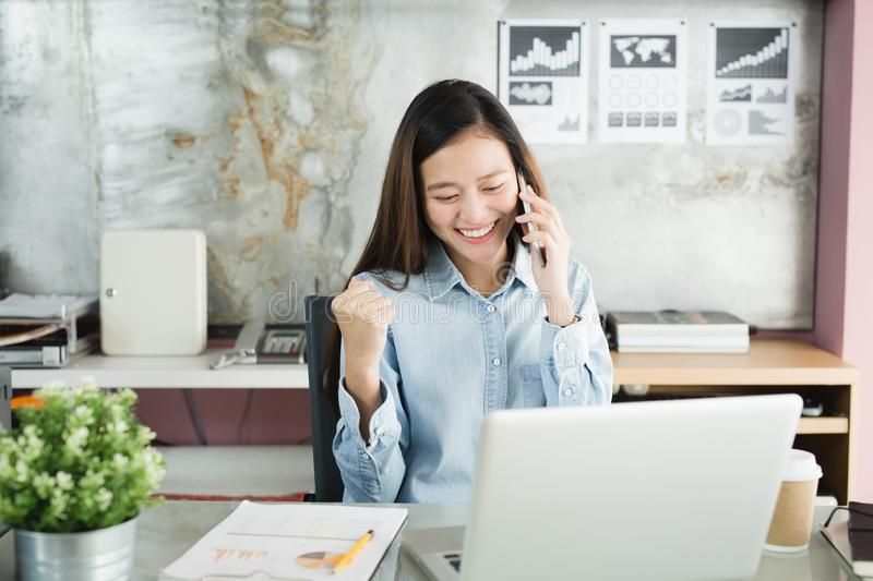 New generation business woman using smartphone,Asian woman are happily working in the office,Working Successful Concept stock image