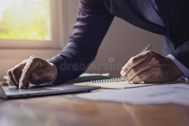 A new generation of businessmen who are working. A new generation of businessmen working on accounts stock image
