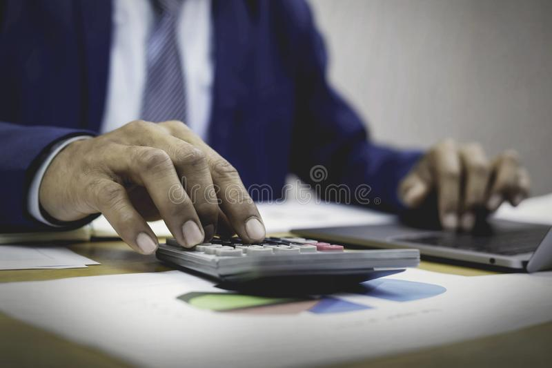 A new generation of businessmen who are working. A new generation of businessmen working on accounts stock images