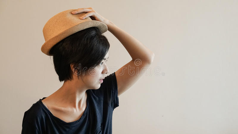 New generation hipster life style short hair Aisan woman with co. New generation hipster life style short hair Aisan woman royalty free stock image