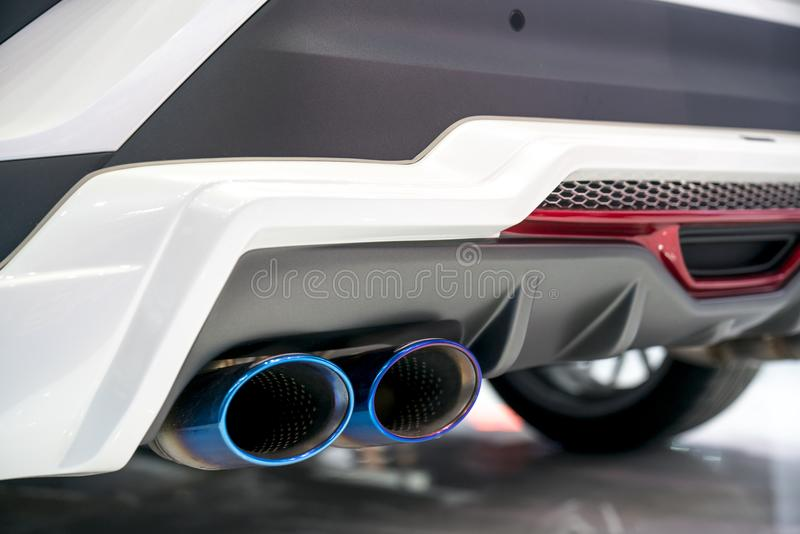 New generation of sportive mufflers. Oval Car Exhaust Tailpipe c. Hromed made of stainless steel on powerful sport car bumper. Close up stock image