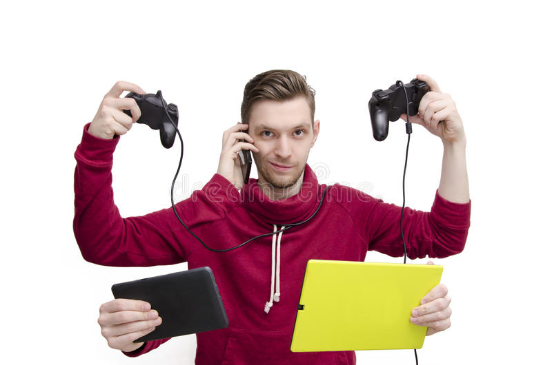 New generation technology concept. Young man with five arms holding tech gadgets stock photography