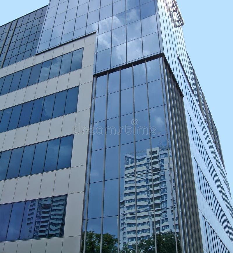 New glass reflective building, blue sky stock photography