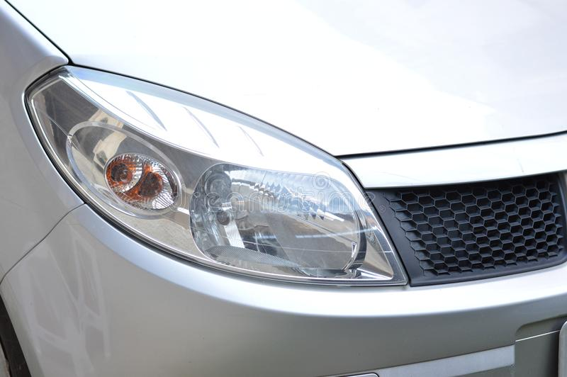 new gray car headlight and arrow, right front view, power, transport, speed royalty free stock photos